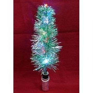 LIT CANDLE TO TWINKLING CHRISTMAS TREE